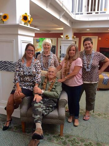 Amy with fellow staff members and a resident